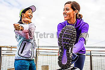 Runners stretching at waterfront, San Francisco, California, United States