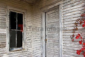 Rustic door, siding and window of wooden house