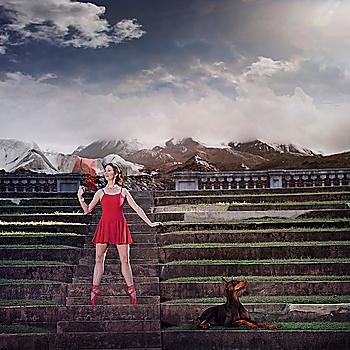Caucasian ballet dancer balancing on ruins