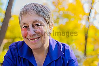 Senior Caucasian smiling outdoors