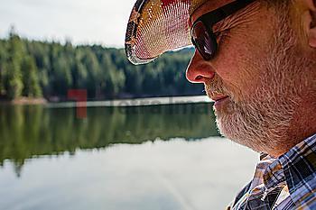Close up of Caucasian man standing near lake