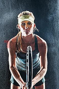 Caucasian tennis player standing in rain