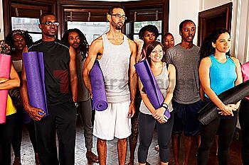 People holding yoga mats