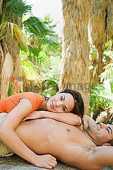 Hispanic couple relaxing in tropical area