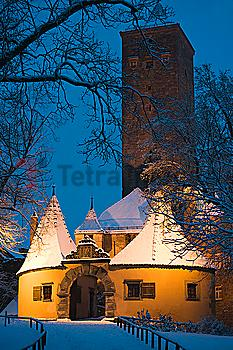 Snow covered village building at night