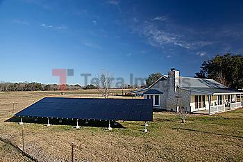 Solar panels outside home in rural landscape