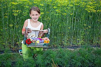 Caucasian girl holding basket of flowers