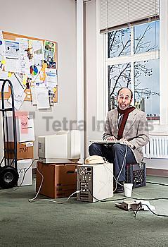 Caucasian businessman working in empty office