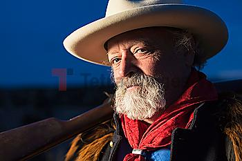 Caucasian man holding gun outdoors