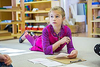 Caucasian girl thinking in classroom