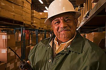 Mixed race man in hard-hat in warehouse