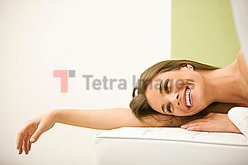 Mixed race woman waiting for spa treatment