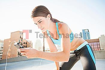 Caucasian runner listening to headphones