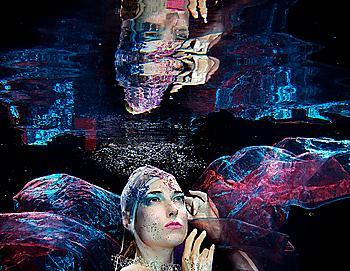 Caucasian woman under water