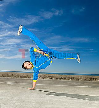Asian woman balancing on one hand