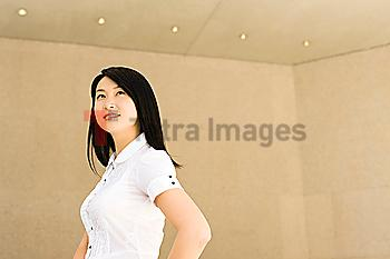 Smiling Chinese businesswoman in office