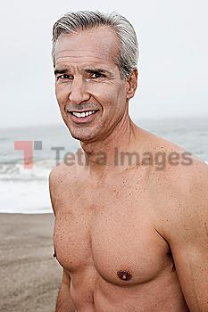 Caucasian man standing on beach