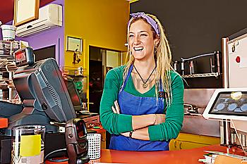 Caucasian woman working in cafe