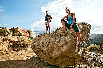 Women standing on rock formation