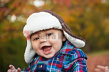 Baby smiling outdoors