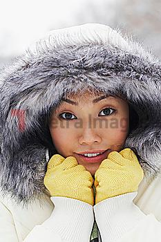 Korean woman in fur-hooded coat