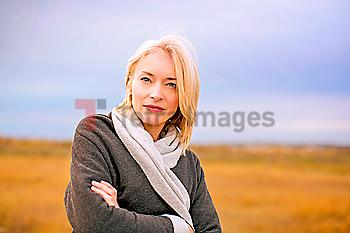Caucasian woman standing in cold rural field