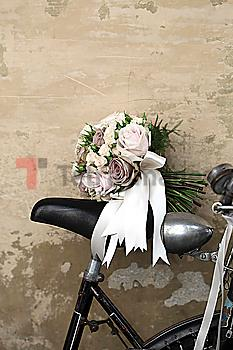 Bridal bouquet on seat of bicycle