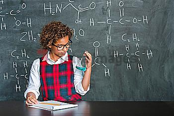 Mixed race student doing experiment in science class