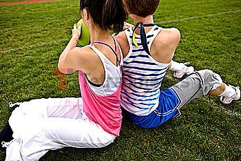 Women working out in field
