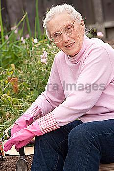 Older Caucasian woman sitting in garden