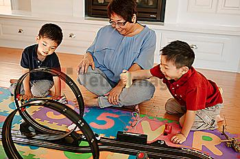 Asian grandmother playing with grandsons