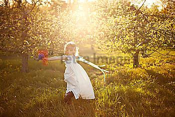 Caucasian girl spinning in grass