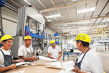 Workers talking in manufacturing plant