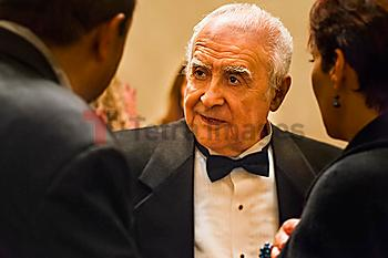 Close up of older man talking to friends