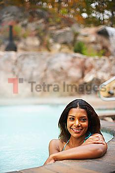 African woman sitting in hot tub