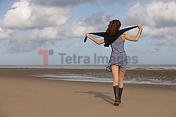 France, Pas-de-Calais, Escalles, Young woman strolling on empty beach