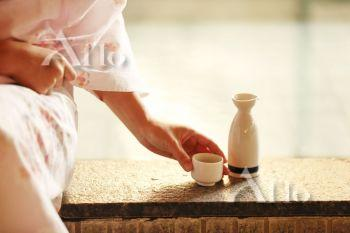 Japanese woman with sake at traditional hot spring, Tokyo, Japan