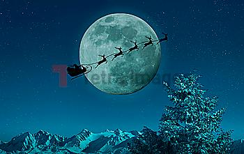 Silhouette of Santa and reindeer flying sleigh near full moon