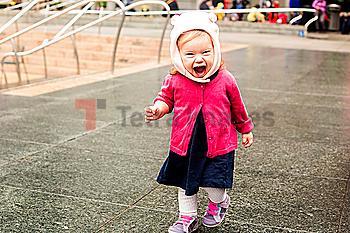Caucasian girl laughing at park
