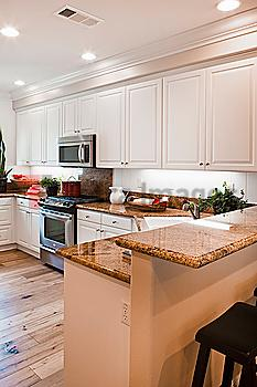 View of a kitchen having white cabinets at home