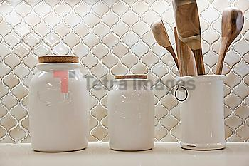 Close-up of jars on shelf at home