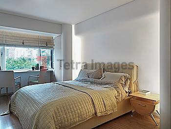 Contemporary bedroom with desk near window