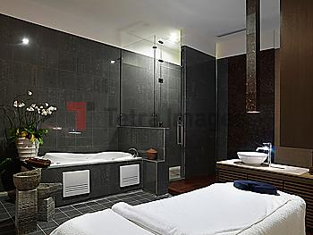 Spa room with hot tub and massage table