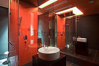 Interior of lit modern bathroom at spa