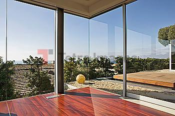 Large Windows and Hardwood Floor