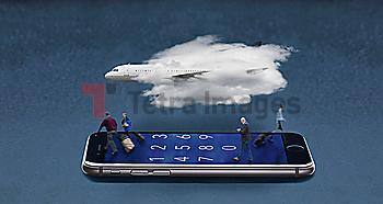 Airplane in cloud floating over travelers walking on cell phone