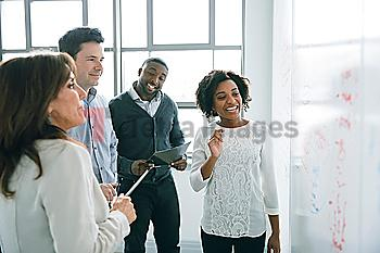 Business people reading whiteboard in meeting