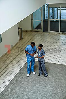 Nurses discussing digital tablet