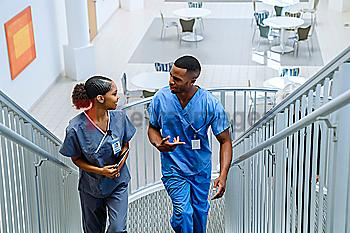 Nurses climbing staircase and talking