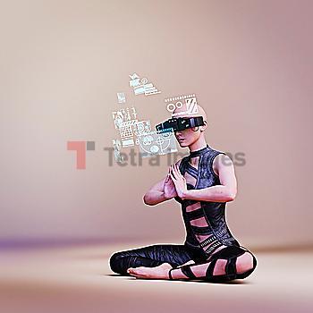 Woman wearing virtual reality goggles while meditating